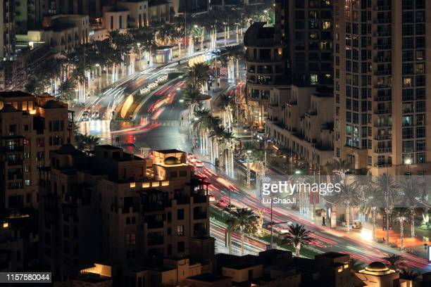 night street view of dubai uae - middle east stock pictures, royalty-free photos & images