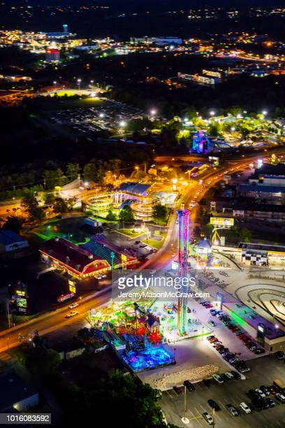 night summer aerial view of hwy 76 strip in branson, missouri - 1011957648,1011945618,1011950492,1011960800,1011954950,1011953954,1015768380,1015768366,1015768370,1015768372,1015768382,1015768398,1015768412,1015768410,1015768414,1015768418,1015768438,1015768448,1015768450,1015768488,1015768474,1015768478,1015768504,1015768508,1016083590,1016083634,1016083592,1016083608,1016083686,1016083708,1016083780,1016083774,1016083796,1016083828,1016083994,1016083992,1016083982,1016083980 stock pictures, royalty-free photos & images