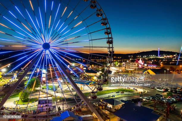 night summer aerial view of the branson ferris wheel in branson, missouri - missouri stock pictures, royalty-free photos & images