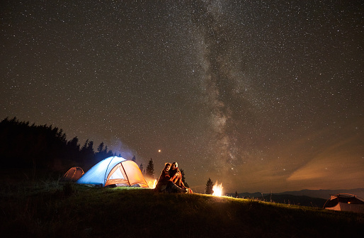 Night summer camping in the mountains under night starry sky 1133646646