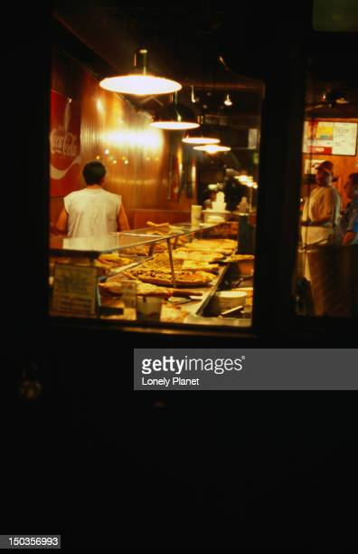 Night time at a New York City pizza joint.