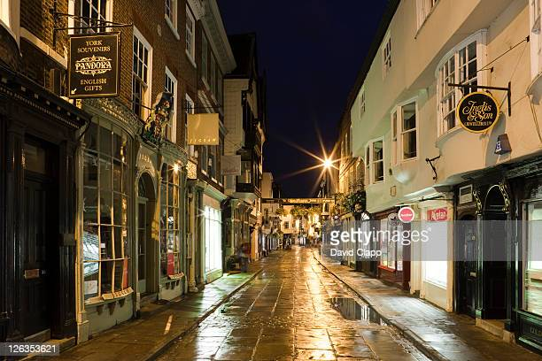night time at petergate, a shopping precinct in york city, east yorkshire, england, uk - north stock pictures, royalty-free photos & images