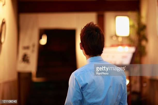 night time businessman in front of the restaurant