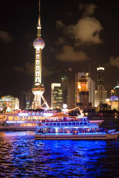 Night time cruise ship on Huang Pu River.