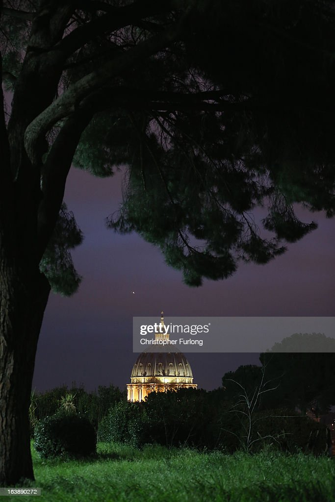 Night time falls over St Peter's Basilica as the Vatican prepares for the inauguration of Pope Francis on March 17, 2013 in Rome, Italy. Daily life continues around the Vatican as Romans prepare for the inauguration mass of Pope Francis, the first ever Latin American Pontiff.