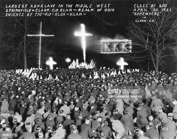 Night time meeting of the Ku Klux Klan in Springfield Ohio with a cross burning The photograph has copy that states 'Class of 600 'somewhere' in...