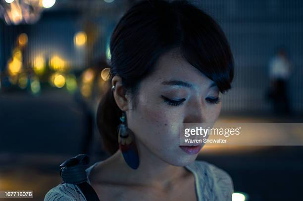 Night time shot of woman in the street