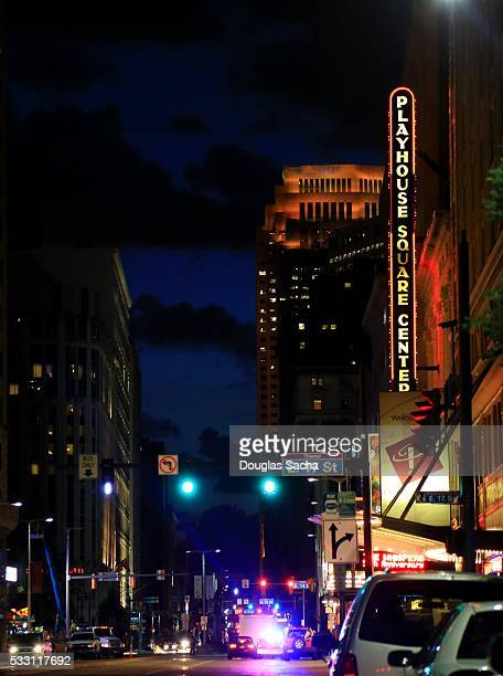 night time street activity at playhouse square theater district in downtown cleveland, ohio, usa - cleveland ohio stock photos and pictures