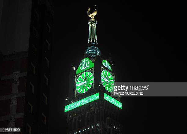 A night time view of the Abraj AlBait Towers seen on June 17 also known as the Mecca Royal Hotel Clock Tower which overlooks the Grand Mosque in the...