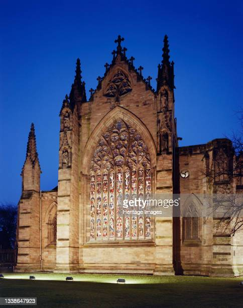 Night time view of the east window at Carlisle Cathedral illuminated by floodlights. This photograph was probably taken by Laing to show work...