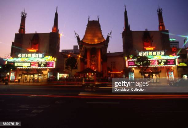 """Night time view of the El Capitan Theater with the movie """"The Naked Gun 2 and a Half"""" on the Marquee in January 1991 in Los Angeles, California."""