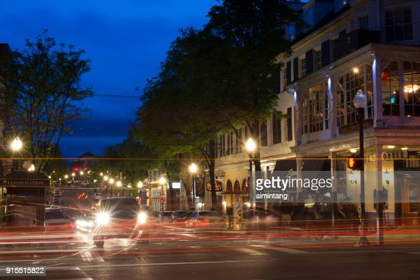 night traffic in the town of state college with people standing outside the corner room restaurant - state college stock photos and pictures