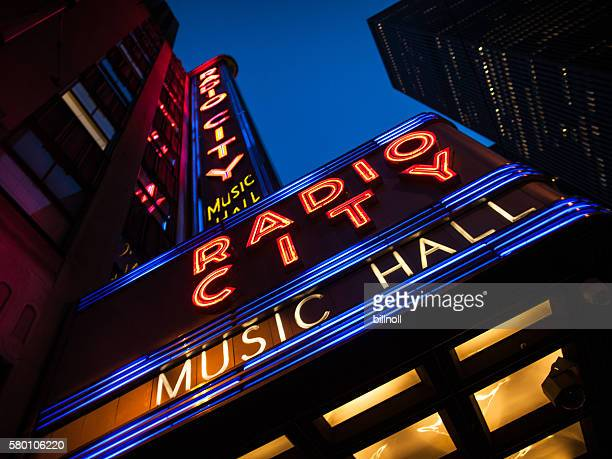 Night upward view of Radio City Music Hall neon sign