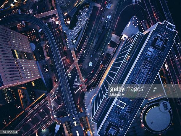night view aerial photography of shiodome - overhead view of traffic on city street tokyo japan stock photos and pictures