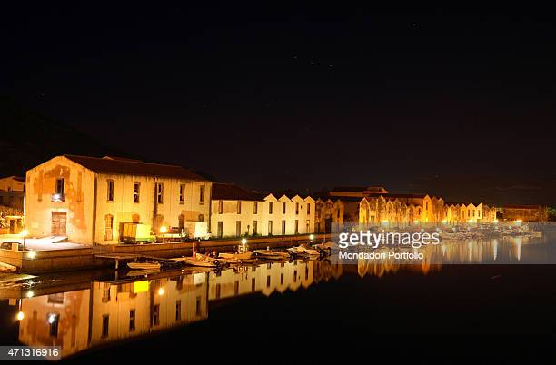 Night view from the Ponte Vecchio The tanneries reflected in the River Temo Bosa Italy April 2006