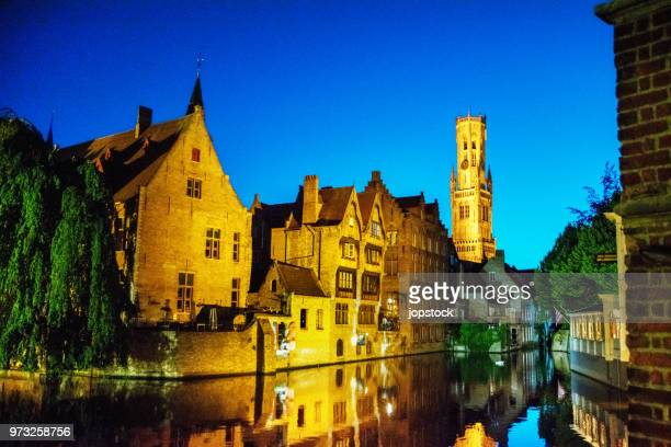night view in bruges, belgium - bell tower tower stock pictures, royalty-free photos & images