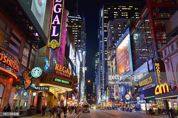 CONTENT] Night view of 42nd Street at Times Square in Midtown Manhattan Night perspective sign signs advertising night busy metropoly metropolis...