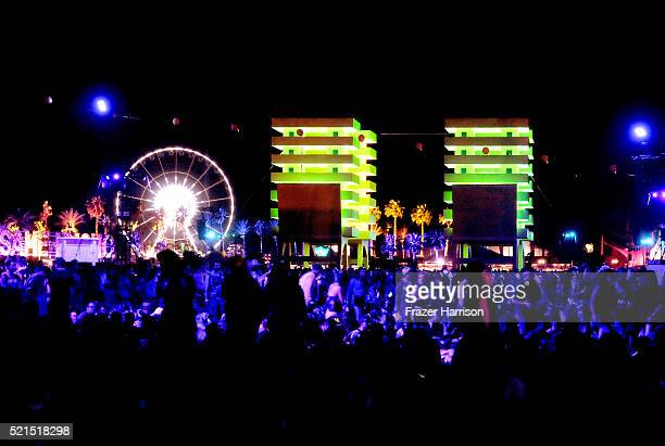 A night view of a ferris wheel and the art installation Katrina Chairs by Alexandre Arrechea during day 1 of the 2016 Coachella Valley Music Arts...