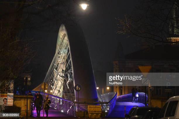 A night view of a fragment of Krakow's Father Bernatek Footbridge and its acrobatic sculptures On Sunday 21 January 2018 in Krakow Poland