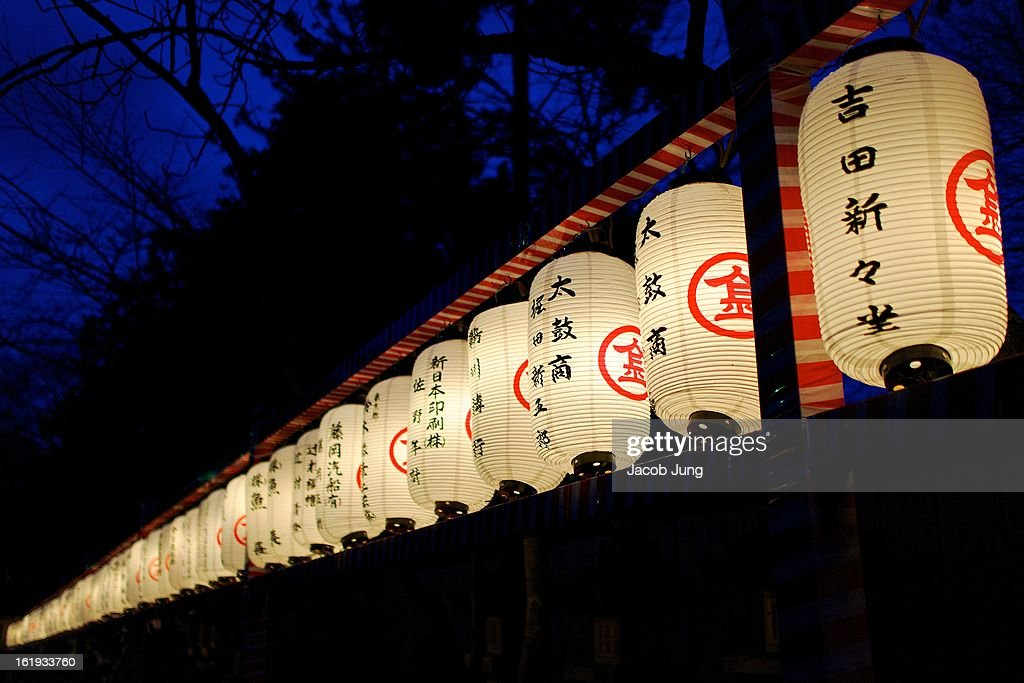 CONTENT] Night view of a line of lit lanterns, adorned with names of individuals and companies who have donated to the shrine, at Konpira-san, more formerly known as Kotohira-gu and Shikoku Island's most famous Shinto shrine. Kotohira, Kagawa Prefecture, Japan. Janurary 1, 2013.