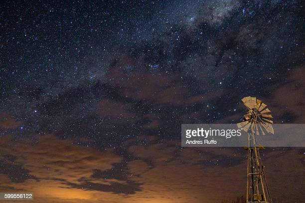 night view of a windmill with background from the center of the milky way - andres ruffo fotografías e imágenes de stock