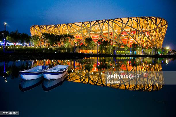 "night view of beijing's ""bird's nest"" stadium - stadio olimpico nazionale foto e immagini stock"