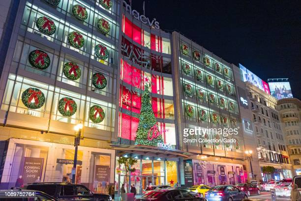 Night view of brightly illuminated facade of the flagship Macy's department store on Union Square in San Francisco, California on Christmas day,...
