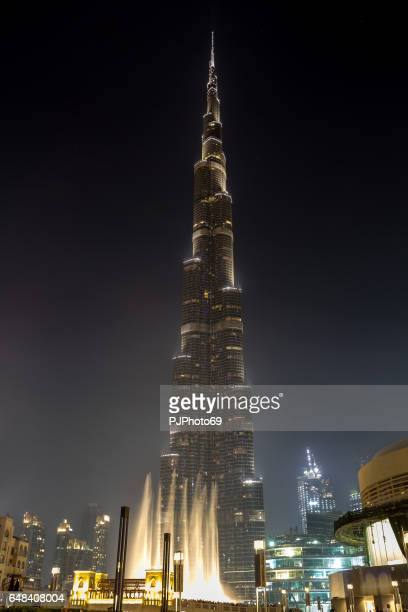 night view of burj khalifa with famouses dancing fountains - pjphoto69 stock pictures, royalty-free photos & images