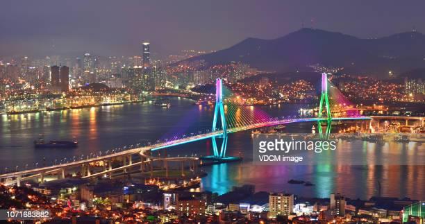 night view of busan north bridge grand bridge vd713 - busan stock pictures, royalty-free photos & images