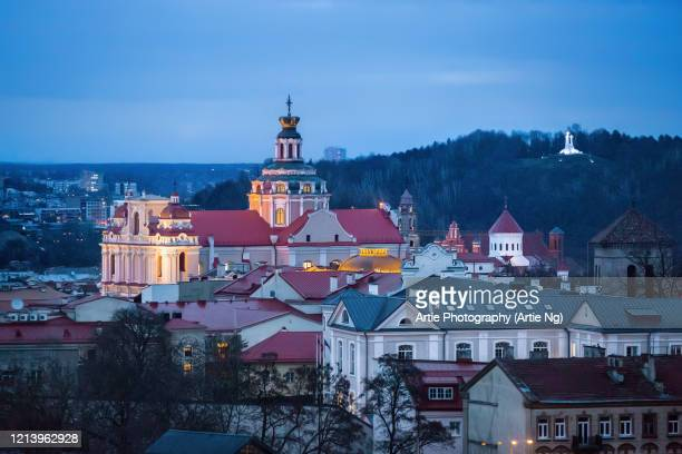 night view of church of st casimir with three crosses in the background, vilnius, lithuania - vilnius stock pictures, royalty-free photos & images