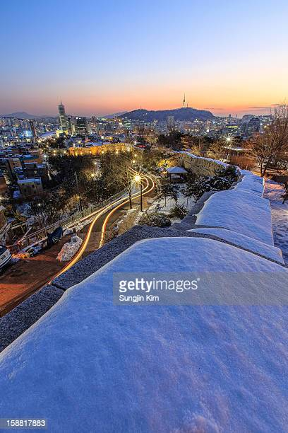 night view of cityscape with fortress wall - sungjin kim stock pictures, royalty-free photos & images