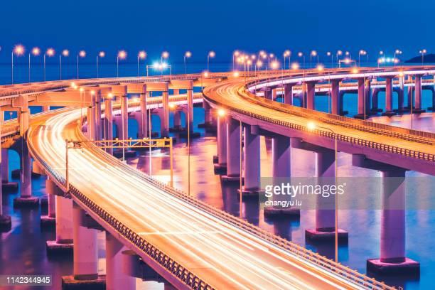 night view of dalian xinghai bay bridge - 高架道路 ストックフォトと画像
