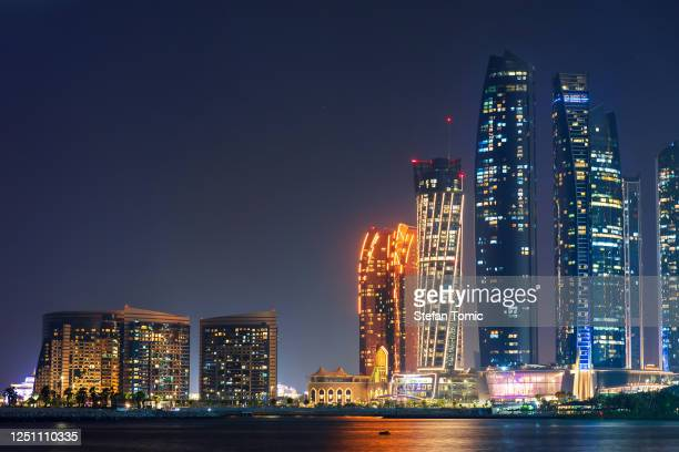 night view of downtown abu dhabi modern architecture in the united arab emirates capital city - abu dhabi stock pictures, royalty-free photos & images