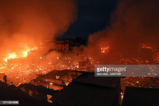 TOPSHOT Night view of Educandos neighbourhood engulfed in flames during a massive fire in Manaus Amazonas state Brazil on December 17 2018 According...