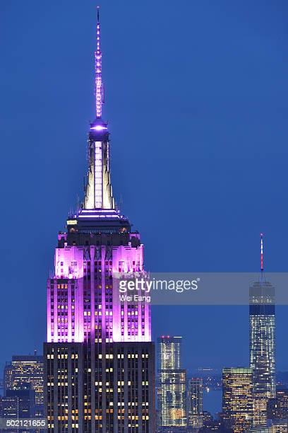 CONTENT] Night view of Empire State Building and One World Trade Center against blue sky