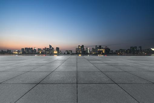 night view of empty brick floor front of modern building 1140684108