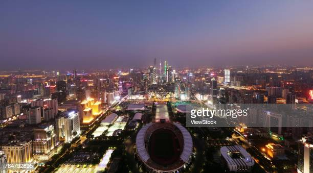 night view of guangzhou city building in guangdong province,china - tianhe stadion stock-fotos und bilder