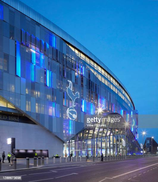Night view of illuminated west entrance. The New Tottenham Hotspur Stadium, London, United Kingdom. Architect: Populous, 2019.