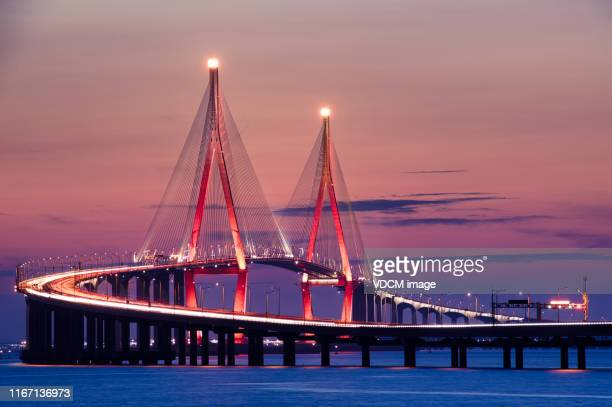 night view of incheon bridge vd702 - incheon stock pictures, royalty-free photos & images