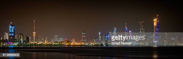 night view of kuwait city skyline - june 13, 2017 - kuwait city stock photos and pictures