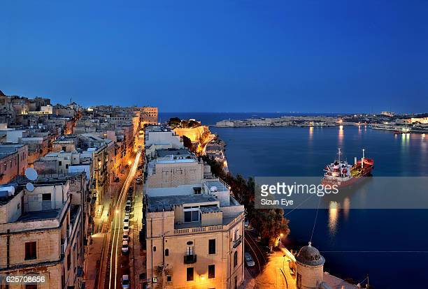 night view of la valletta streets with the northern part of grand harbour in malta. - valletta stock pictures, royalty-free photos & images