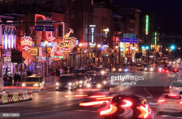 night view of lower broadway - nashville stock pictures, royalty-free photos & images