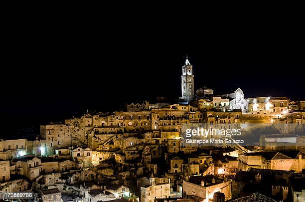 CONTENT] Night view of Matera old town the Sassi The ancient town grew in height on one slope of the ravine created by a river that is now a small...