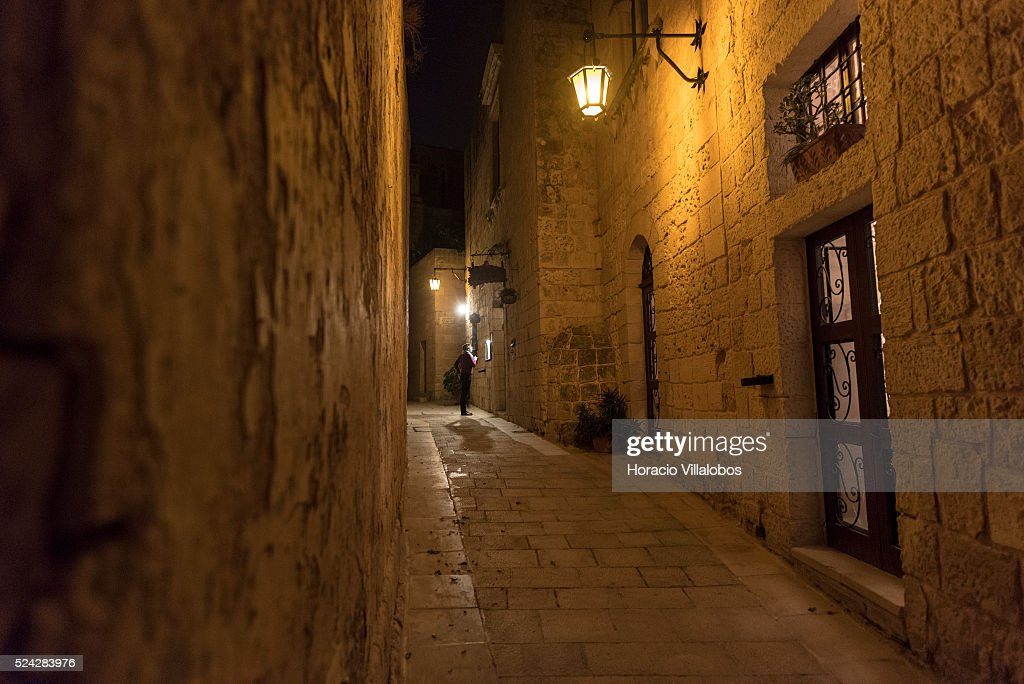 Night view of Mdina, Malta, 21 October 2015. Also known as Citt������ Vecchia or Citt������ Notabile, it is a medieval walled town situated on one of the highest points on the island. It served as the island's capital from antiquity until 1530. Mdina is. Punic remains uncovered beyond the city's walls suggest the importance of the general region to Malta's Phoenician settlers. The town is still confined within its walls, and has a population of just under 300.