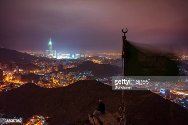 night view of mecca from hira cave at night. - hajj stockfoto's en -beelden