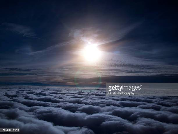 Night view of moon over clouds from aircraft