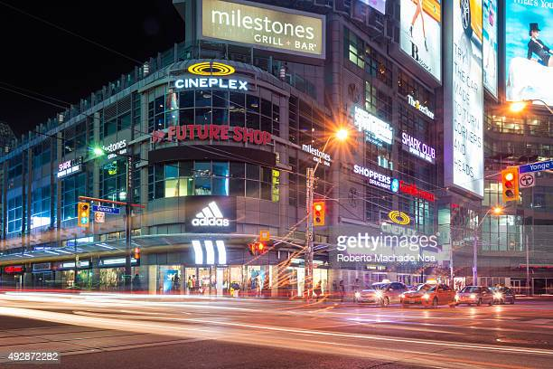 Night view of multi storeyed corner building at the Yonge Dundas Square with numerous shopping establishments restaurants and a Cineplex The brightly...