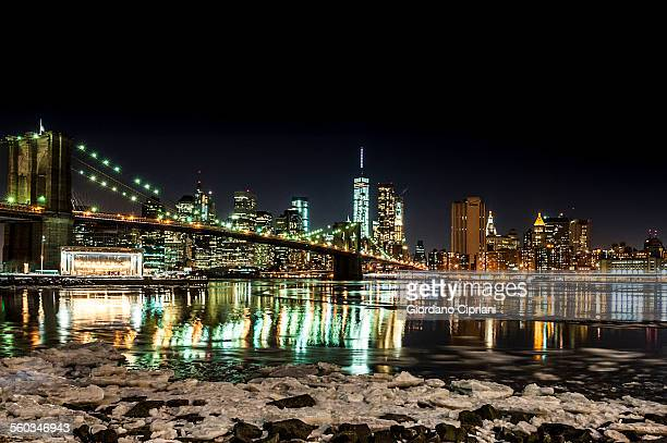 night view of new york city with east river frozen - cipriani manhattan stock pictures, royalty-free photos & images
