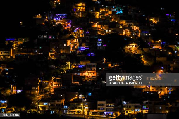 Night view of one of the Belen Zafra neighborhoods decorated with Christmas lights in Medellin Colombia on December 4 2017 According to EPM who is in...