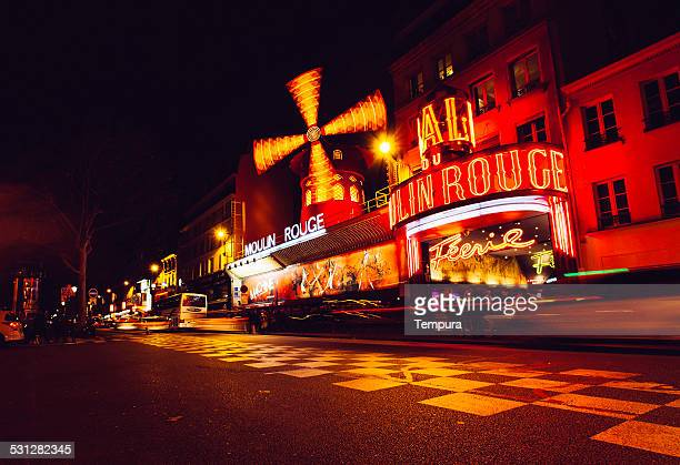 night view of paris moulin rouge cabaret. - cabaret stock pictures, royalty-free photos & images